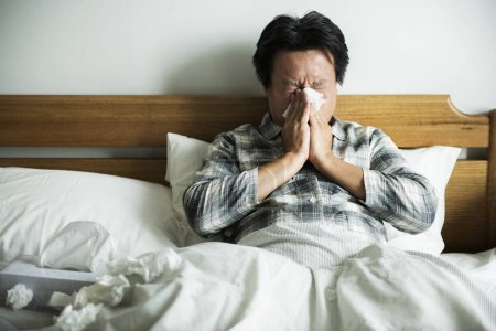 sick Asian man in bed