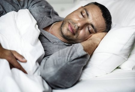 man sleeping on a bed