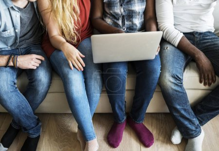 Photo for Group of diverse friends hanging out and using digital devices - Royalty Free Image