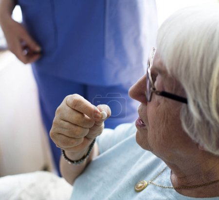 Senior woman taking pill