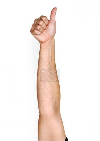 Hand of caucasian human showing symbol good