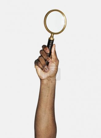 Hand holding variation of magnifying glass