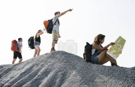Friends backpackers traveling on apex