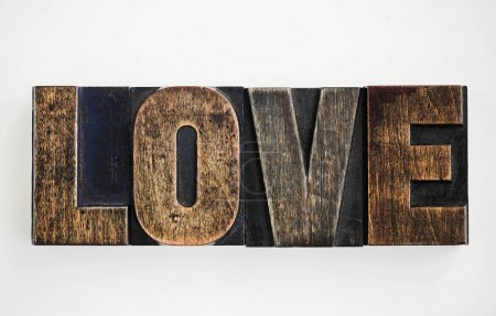 "Closeup of the word ""Love"" isolated on white background, original photoset"