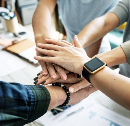 Hands stacking support each other