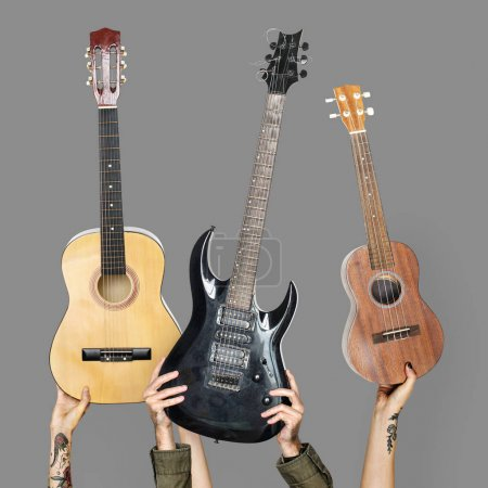Photo for People hands holding different guitars - Royalty Free Image