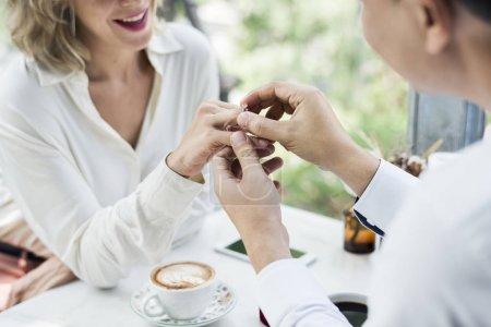 Man proposing girlfriend with diamond ring
