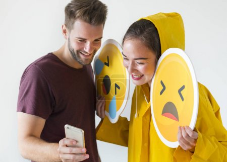 Couple taking selfie with emojis