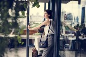 """Постер, картина, фотообои """"brunette woman stepping out of door in cafe """""""