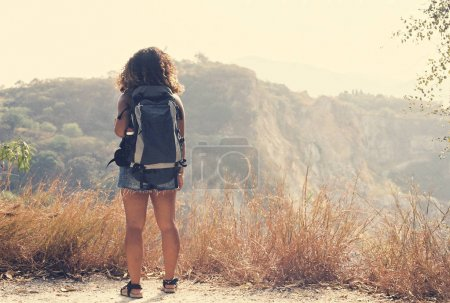 Woman with backpack traveling
