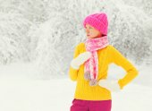 Fashion winter young woman wearing colorful knitted hat, sweater