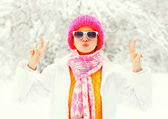 Fashion winter young woman wearing colorful knitted hat, scarf h