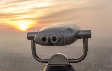 Photo for Tourist telescope  with city view at sunset - Royalty Free Image