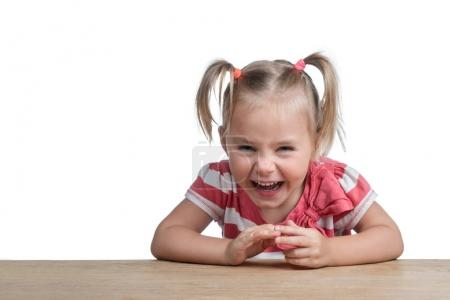 Laughing positive child at the table