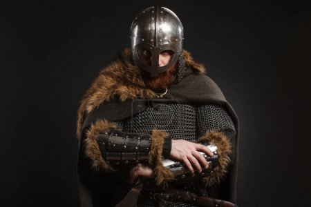 Photo for Warrior Viking in full arms with axe on dark background - Royalty Free Image