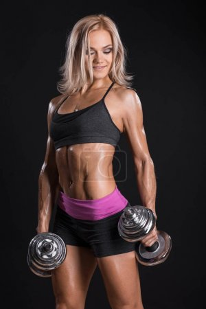 Photo for Female bodybuilder in sports clothing ready for gym exercise with dumbbells. Close up - Royalty Free Image