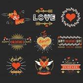 Red and golden Valentines day emblems and design elements set on black background