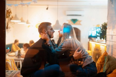 Photo for Young couple in cafe with stylish interior. Students spend time in a cafe - Royalty Free Image