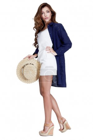 Photo for Summer catalog collection of clothes beautiful sexy model wear blue cotton shirt over white short blouse accessory straw hat style for romantic date beach party travel casual fashion magazine tourism. - Royalty Free Image