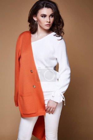 Beautiful pretty sexy woman wear white wool knitted sweater pant