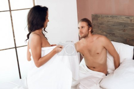 Young passionate couple has sex on bed. Sexual relations among young people. Intimate affinity. Adult sexual relationships.
