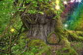 Tree with fairy lights, door and rainbow