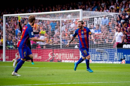 Lionel Messi right celebrates a