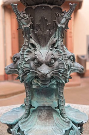 Bronze base of the Herkules fountain in the courtyard of the town hall Roemer, Frankfurt, Germany