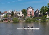 Row boat in front of the Old Town of Frankfurt-Hoechst
