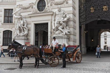 Traditiona fiacre near Hofburg in Vienna
