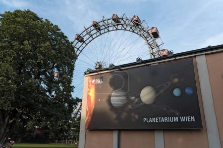 Old ferris wheel and the planetarium in the amusement park Prater, Vienna, Austria