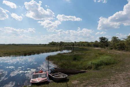 Boats on the shore of the Linyanti River and Swamp, Namibia
