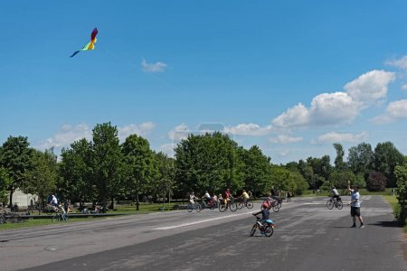 FRANKFURT, GERMANY-MAY 25, 2017: Boy makes a kite climb on the nature and recreation area. Old airfield in Frankfurt-Bonames