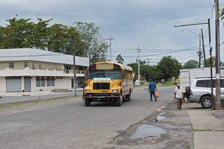GUABITO, PANAMA-MARCH 18, 2017: Yellow city bus in Guabito (Panama) on the border to Costa Rica