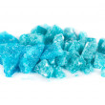 Blue crystal of methamphetamine isolated on white ...
