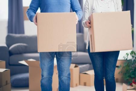 Couple with boxes with stuff