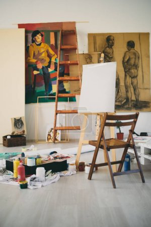 Painting studio interieour. Easer, chair, colors and paintings a