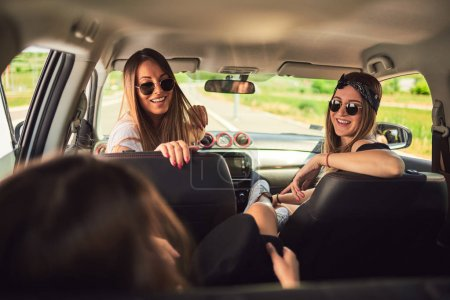 Photo for Three young women having fun on roadtrip. - Royalty Free Image