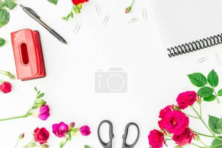 Workspace with notebook, pen, scissors