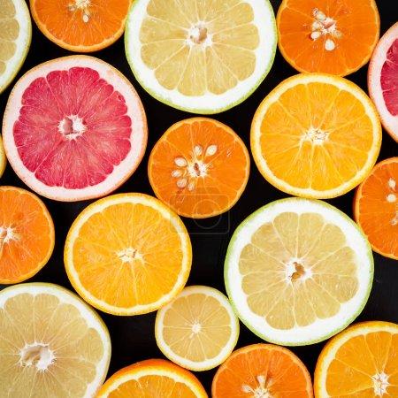 citrus fruits on dark background