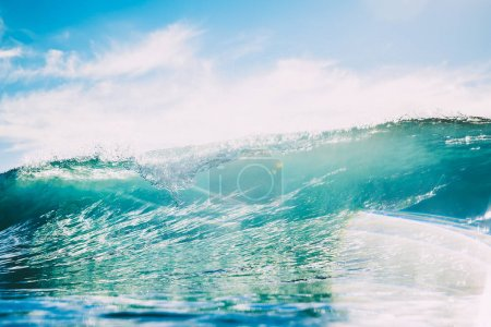 Blue wave in ocean. Clear wave and sun light