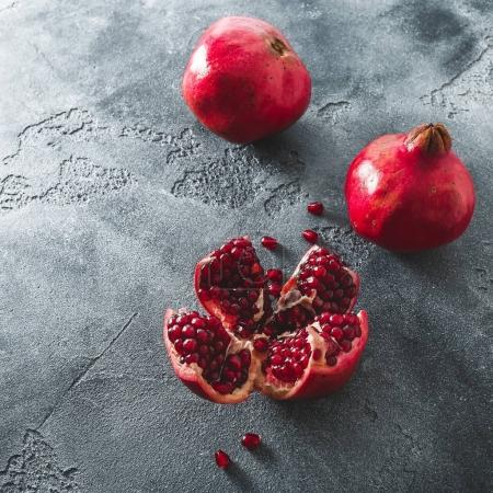 Pomegranate on dark background. Flat lay, top view. Food concept
