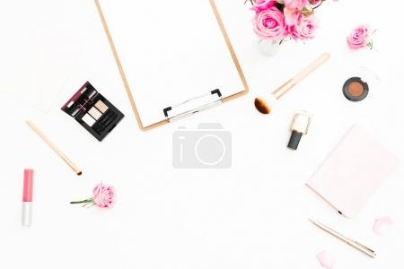 Photo for Woman workspace with pink roses, cosmetics, diary and clipboard on white background. Top view. Flat lay. Valentines day. - Royalty Free Image