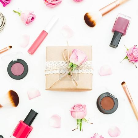 Woman workspace with gift box, pink roses, cosmetics, diary on white background. Top view. Flat lay. Valentines day.