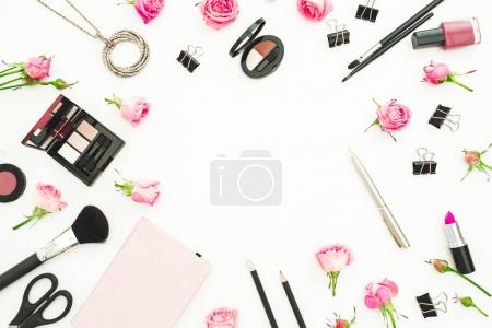 Photo for Female workspace with cosmetics, accessories and pink roses on white background. Top view. Flat lay. Beauty blog background - Royalty Free Image