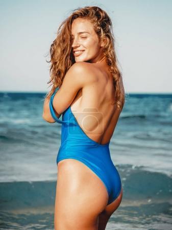 Photo for Beautiful young girl relaxing on a beach, wearing stylish bikini - Royalty Free Image