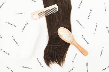 Frame with combs for hair styling, hairpins on white background. Beauty blog composition. Flat lay, top view