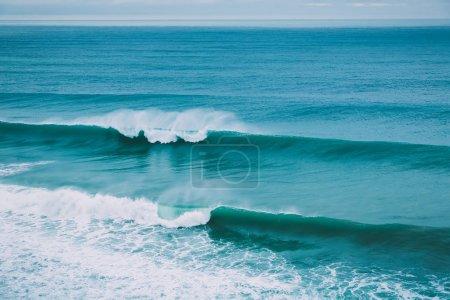 Blue waves in ocean at daytime