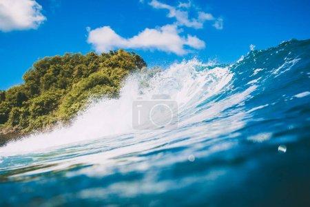 Blue wave in ocean. Breaking wave and sun light in Bali