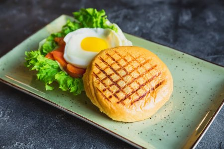 Delicious Burger with egg, lettuce and salmon fish
